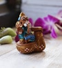 Aapno Rajasthan Brown & Blue Terracotta Ganesh Sitting on Tabla Showpiece