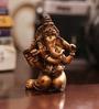 Aapno Rajasthan Brown Resin Cute Ganesha Showpiece Sitting on His Knees