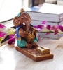Aapno Rajasthan Multicolour Terracotta Sitting & Book Reading Ganesh
