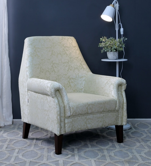 Enjoyable Adrian Wing Chair In Floral Beige Colour By Casacraft Machost Co Dining Chair Design Ideas Machostcouk