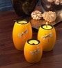 Asian Artisans Yellow Wood Oval Candle Stand - Set of 3