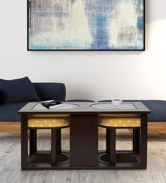 Attractive Coffee Table With Two Cushioned Stools In Ochre Colour