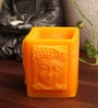 Yellow Buddha Hurricane Candle by Candles N Beyond