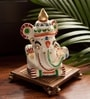 Exclusivelane Brown & Off White Terracotta & Wood Hand Painted Ganesha with Ghunghroo Chowki