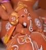 Exclusivelane Brown Terracotta Hand Painted Baby Ganesha Sitting Inside The Matki
