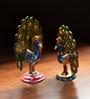 Multicoloured Metallic Dancing Meenakari Peacock Showpieces - Set of 2 by ExclusiveLane