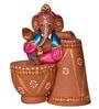 ExclusiveLane Brown Terracotta Hand Painted Tabla Sitting Ganesha Idol