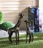 Multicolour Brass Giraffe Pair Showpiece by Handecor