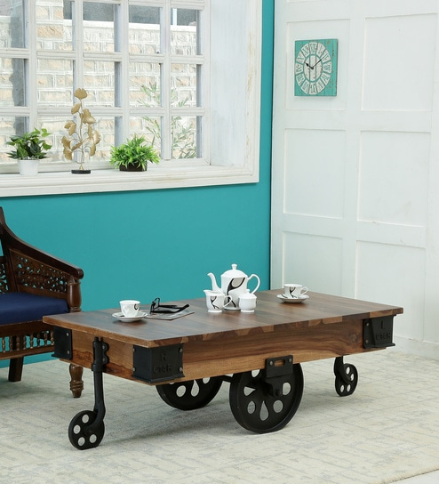 Buy Jonas Coffee Table With Wheels In Rustic Teak Finish By