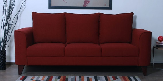 Lara Three Seater Sofa in Garnet Red Colour by CasaCraft