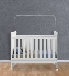 McSilvie Baby Crib in Satin White by Mollycoddle at pepperfry