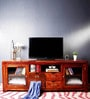 Peshtigo Entertainment Unit with Four Drawers in Honey Oak Finish by Woodsworth
