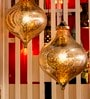 Gold Glass Pendant Lamp by Sahil Sarthak Designs