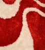 Reds Polyester Rectangular Abstract Patterns Area Rug by Shobha Woollens