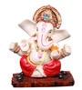 The Nodding Head White Polyresin Ganesha Sitting on Wooden Base in Red Dhoti