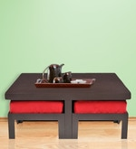 Trendy Coffee Table with Four Red Cushioned Stools